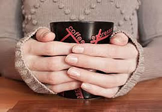pair_of_hands_holding_coffee_express_mug.jpg